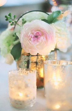 Fantasy Wedding Ideas: This simple yet romantic centerpiece is perfect for a fantasy wedding without going over the top! Photo by Christine Farah on Stye Unveiled