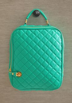"Quilted Delight IPad Case In Teal 34.99 at shopruche.com. Keep your iPad safe from bumps and scratches with this charming teal iPad case in quilted leatherette. Finished with an optional shoulder straps, a padded interior, and a zipper and push lock closure.9"" L x 12"" H x 2.25"" W, -3"" strap drop, -1 interior zipper pocket, -2 interior organizer pouches"