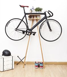 The Bike Wardrobe is a unique and modern furniture design and concept. Bike Rack is made from solid alder and acacia wood. The clever design keeps the bike clean and shining by keeping it off the ground up and away. Hanging Bike Rack, Bicycle Storage Rack, Indoor Bike Rack, Bike Hanger, Bicycle Rack, Storage Racks, Bicycle Stand, Rack Shelf, Bike Wall