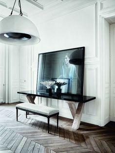 herringbone floor, sideboard and black and white artwork