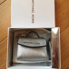 NEWMichael Kors Ava Key Fob NEWMichael Kors Ava Key Fob. Comes with Gift Box!  This listing is for the silver. I also have the pearl Gray listed too!no trade no PayPal no holds✅10% off bundles Michael Kors Accessories Key & Card Holders