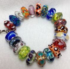 No Rhyme, No Reason, No Silver!  A colorful bracelet  by a Trollbeads Gallery Forum member!  Join us to see some great bracelets! http://trollbeadsgalleryforum.ning.com