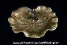 Beautiful vintage brass lily pad dish tray with flower,very unique and decorative! Measuring approximately 9 x 6 inches and 3 1/2 inches tall. It has a wonderful natural aged patina and is in great vintage condition. makes a beautiful addition to your home.
