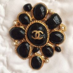 "Authentic Chanel Brooch Gorgeous vintage looking authentic and rare Chanel brooch.  Gold with black shinny enamel and tiny pearls.  Stamped ""B11 CC A- Made in Italy"" on the back.  Unfortunately I no longer have the box it came in.  In excellent condition! *No trades* CHANEL Jewelry Brooches"