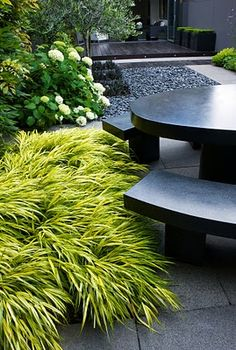 Charlotte Rowe garden design  // Great Gardens & Ideas //  interesting leafy plant/plant combos. Nice pic