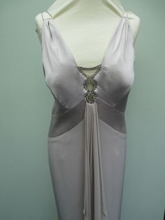 silver/beige satin with thin stras very low back and bead detail and train, simply gorgeous