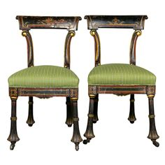 A pair of small Egyptian Revival side chairs.  Painted and gilded wood. English or American, Circa 1880