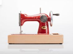 Cute Toy SEWING machine made by Soviets. USSR made rare vintage RED sewing machine in good condition. Original packaging