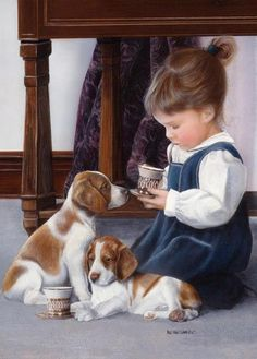 Little girl having a tea party with her puppies.