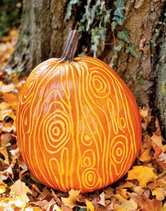 pumpkin with swirl pattern carved in it