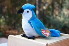 Rocket Blue Jay is a retired (December 23, 1999) Beanie Baby. This plush bird would make a special gift for a sports fan or addition to your beanie baby collection. Description: royal blue and white body, black felt beak and feet, black plastic eyes Height: @ 5½ inches tall and @