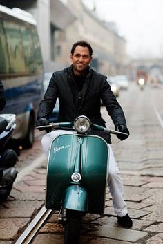 Italian man & Vespa... a common sight in Italy! I did NOT see any man that looked like this over there !! :>D