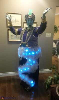 Kelly: I made this costume using a bag of Halloween spider webs and LED lights on a black skirt. I made all of the other elements as well. I fashioned the...