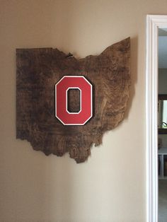 Ohio State wooden cutout  Large wall hanging with a custom wooden block O on top. Once piece. Approximately 24 by 27 and about 3/4 thick.