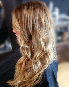 Beautiful honey blonde hair color. Great for summer!