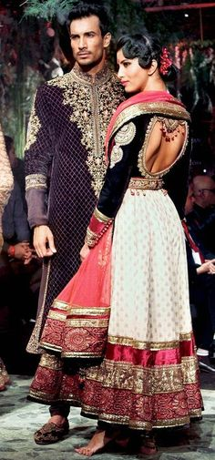I'll pretend I'm pinning this because of the beautiful sherwani and lehenga.  I'm really posting it because that man is smokin' hot!