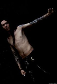 Marilyn Manson<<< That is the best shirt I've seen him wear. XD Love him.
