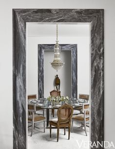 dining room with round table and mismatched chairs #dining Love the marble casing