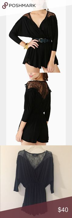 Nasty Gal black lace romper Super flirty romper with sheer lace paneling on the back and sides of the shorts. Has an elastic cinched waist for a flattering fit. Nasty Gal Dresses