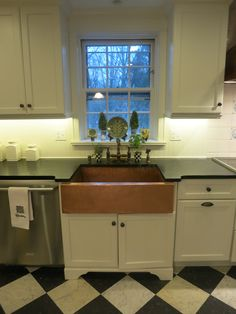A gorgeous undermounted matte copper kitchen sink pops in this black & white kitchen! | Photo provided by a valued CopperSinksOnline.com customer!