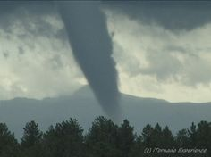 Tornado in the Mountains! This EF-1 tornado touched down on August 18th 2009 at the astonishing elevation of 9,507 ft. near Wilkerson Pass & Lake George, CO - (Pikes Peak is in the background)