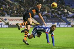 Summer signing Ciaran Clark (left) sends Wigan's Andy Kellett tumbling to the turf as they challenge for the ball