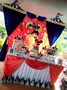 Backdrop & cake / candy table for a Sorcerer Mickey 1st birthday party! Design & setup by ParteeBoo - The Party Designers
