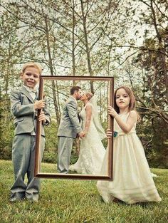 """Love-ly Work of Art -Vesuvius Vineyards A Love-ly work of art! Ring-bearer and flower girl hold up a frame to """"frame"""" the bride and groom.A Love-ly work of art! Ring-bearer and flower girl hold up a frame to """"frame"""" the bride and groom. Trendy Wedding, Dream Wedding, Wedding Day, Wedding Rings, Wedding Anniversary Photos, Wedding Parties, Timeless Wedding, Wedding Beauty, Wedding Picture Poses"""