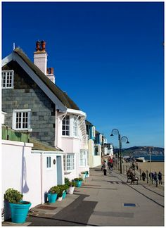 Lyme Regis, Dorset Loved these houses. People had their dining tables out on the terrace in the evenings, all the family round, was lovely to see/hear! England Uk, Dorset England, British Isles, British Seaside, Dorset Holiday, Somerset Place, Weymouth Dorset, Dorset Coast, Lyme Regis