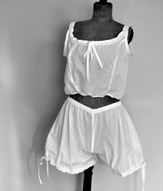Victorian Camisole and knickers in beautiful white Lawn. Lawn is a lightweight, sheer cloth, crisper than voile but not as crisp as organdy. Lawn is known for its semi-transparency, which can range from gauzy or sheer to an almost opaque effect, known as lining or utility lawn. The finish used on lawn ranges from soft to semi-crisp to crisp, but the fabric is never completely stiff.