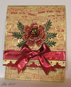 pocket card by quilterlin, via Flickr  Like the gold embossing on red music.