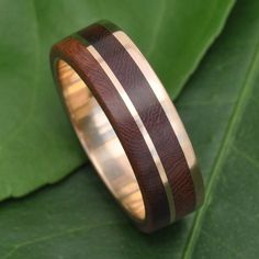 Gold Un Lado Asi Wood Ring 14k Recycled Yellow Gold and Nacascolo Wood Ring  Rich brown nacascolo wood with a side stripe and offset line of recycled 14k yellow gold interior and exterior. This unique, modern but timeless design makes the perfect engagement, wedding or commitment ring, or accessory.  Each ring is made to order in the size you request with 7mm width. Rings are available in whole, half and quarter sizes. If you would like another width, please contact us for a custom listing…