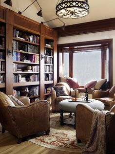 Family room bookshelves family room traditional with leather armchairs wood molding built in shelves