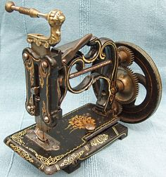 This early chain-stitch sewing machine, which dates to the late1860's, was produced by Charles Raymond, Guelph, Canada. It was sold in the U.K. by James Weir as The American Hand Sewing Machine, and has Jas G. Weir, along with their shop address - 2 Carlisle Street London - stamped on the needle-plate.