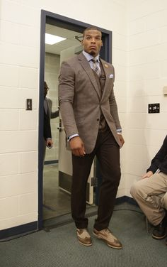 Carolina Panthers quarterback Cam Newton arrives in style in our new favorite fall get up: neutral shades of brown from head to toe. (AP Photo/Stephen Brashear)