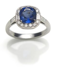 Richard Ogden Art Deco-style cluster engagement ring in platinum, set with a 2.03ct cushion-cut Sri Lankan sapphire framed by mille grain-set diamonds (£8,300).