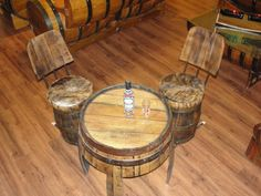 For the patio...Tequila barrel coffee table with two chairs by TequilaBarrelCrafts