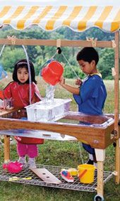 Preschoolers at a sand and water table