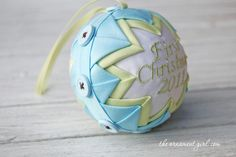 A baby's first Christmas ornament idea.