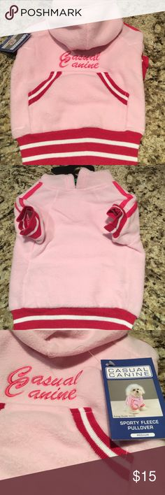 Canine Casual sporty fleece pullover sweater Canine Casual sporty fleece pullover sweater in hot pink!!  So adorable and comfy, take your pooch out in style!!  Brand new and never used still in original package.  Could fit a beagle, bichon frise, cocker spaniel, corgi, terrier, shih tzu, west highland terrier, whippet.... machine washable for easy care canine casual Sweaters