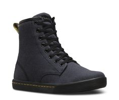 A slim, sneaker-inspired 7-eye boot, the Sheridan is a youthful interpretation of Doc's DNA, with the ability to lace it up for high-top style — or folded down, and snapped. Convertible high-top style, with the ability to fold and snap down SoftWair™ memory foam comfort insole Medial side air-vents Cemented sole construction, with a rubber sole Made with Woven Textile, a fabric using polyester and cotton Retains tons of Doc's DNA, like grooved sides, a yellow sidewall thread and a scr... Mens High Top Shoes, Mens High Tops, Women's Boots, Black Boots, Shoe Boots, Doc Martens Boots, Dr. Martens, All Black Sneakers, Shoes Sneakers
