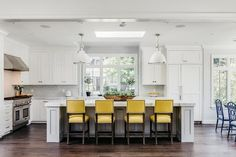 Light gray kitchen island with yellow leather counter stools - transitional Grey Yellow Kitchen, Black Kitchen Island, White Kitchen Backsplash, Stools For Kitchen Island, Neutral Kitchen, Kitchen Cabinets, Kitchen Colors, White Cabinets, White Cottage Kitchens