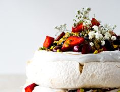 An Australian Christmas classic made vegan using the magic of aquafaba (chickpea water). Crisp meringue embedded with pistachios, topped with pillowy vanilla whipped coconut cream, berries tossed with golden saffron sugar, crunchy-tart passionfruit and an extra scattering ofpistachios.  Pavlova. An Australian Christmas would not be complete without one. It's tradition, just as a Christmas pudding is tradition in England. Trifle plays it's part here sure, but I was never particularl...