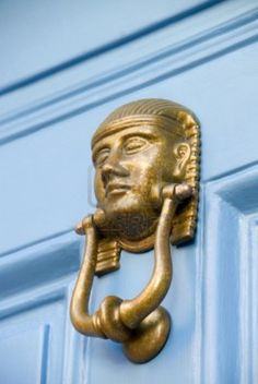 A door knocker in the style of an Egyptian pharaoh.