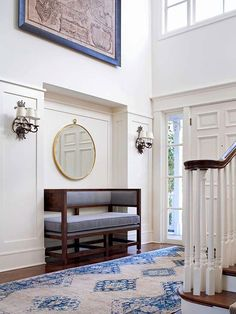 This shallow niche in an outsize foyer asks not just for a statement piece; rather, it begs for an exclamation! http://www.bhg.com/rooms/rooms/entryway/front-entry-decor-ideas/?socsrc=bhgpin051814suitedinscale&page=12