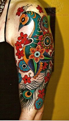 I love how the flowers are integrated into this. I would even love for the folk flowers to go down my ankle to my foot. I think it would make something with an owl look really elegant.