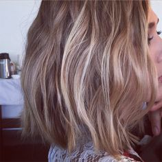 "Here's More Proof That the Wavy Bob Is 2015's ""It"" Cut - It Doesn't Require Much Styling: The main point is that hair is supposed to look a bit messy—so don't expect to spend hours with the curling iron. Instead, sleep with two braids and tame the waves with texturizing spray and one sweep of the flat iron."