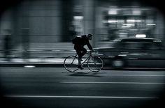 Dark shot of a bike rider on a fixie or singlespeed bike