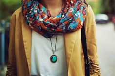 multi color scarf, mustard jacket, gorgeous pendant necklace