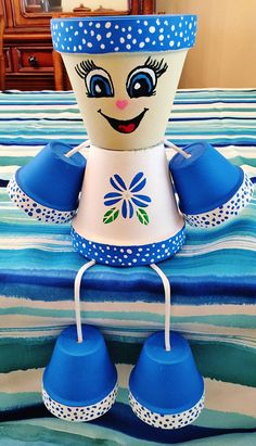 Blue Flower Dots Clay Pot Head People Terra Cotta - It's a Girl Flower Pot Art, Clay Flower Pots, Flower Pot Crafts, Clay Pot Projects, Clay Pot Crafts, Diy Clay, Flower Pot People, Clay Pot People, Painted Clay Pots